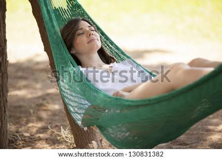 Falling asleep in a hammock - stock photo