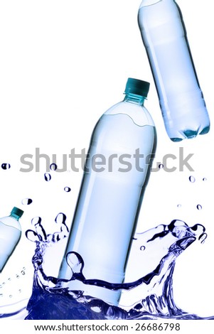 Falling bottles of pure water isolated over white background