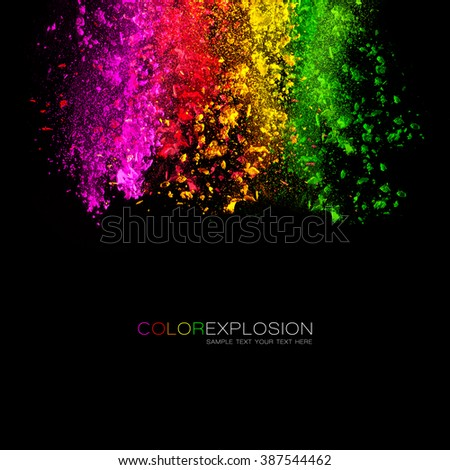 Falling colored powder. Rainbow of pink, red, orange, yellow and green dust over black background. Template design with sample text - stock photo