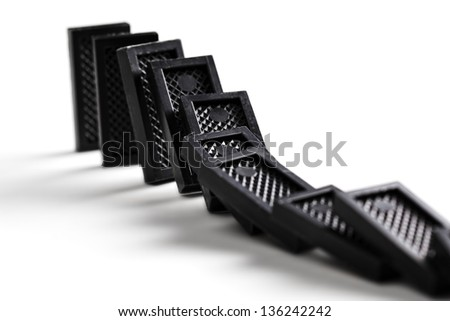Falling dominoes in motion against white background