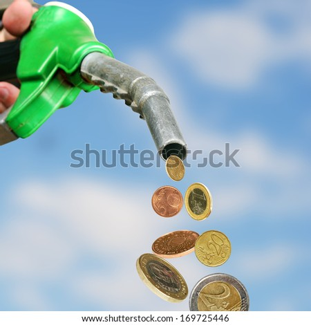 falling Euro coins from gasoline gun - stock photo