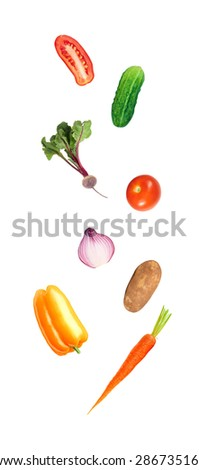 Falling fresh color vegetables - stock photo