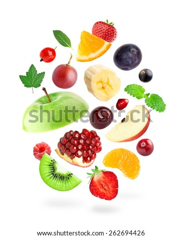 Falling fresh fruits and berries on white background
