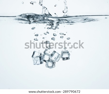 Falling ice cubes in water