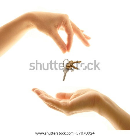 Falling keys in a female hand from new apartment - stock photo