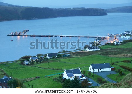 Falling nioght over Uig harbour and village, Isle of Skye, Trotternish peninsula, Scotland, UK - stock photo