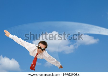 Falling or flying businessman with dark goggles and white contrail - against blue sky - stock photo