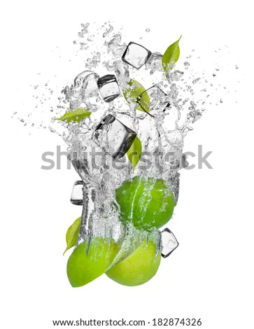 Falling pieces of limes in water splash and ice cubes, isolated on white background