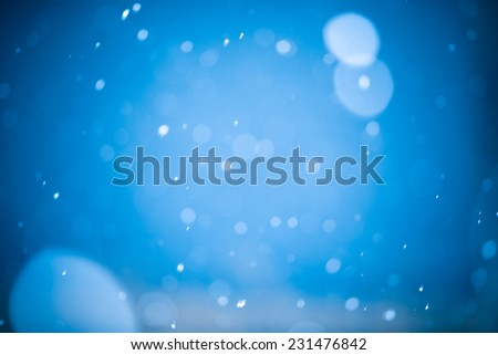 Falling Snow On The Blue Background - stock photo