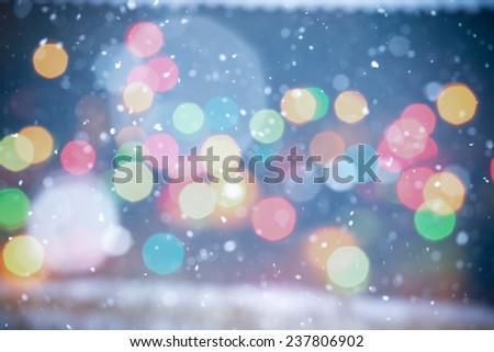 Falling Snow with Multicolor Bokeh On The Blue Background - stock photo