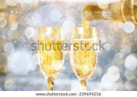 Falling Snow with Two Champagne Glasses On The Blue Background - stock photo