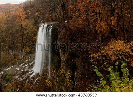 Falling Springs waterfall in the western part of Virginia, surrounded by beautiful autumn foliage,  This is a hidden treasure that can be found just outside of Covington in the Blue Ridge Mountains. - stock photo