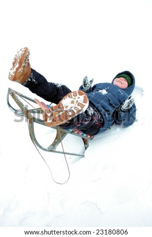 Falling to the snow. Winters riding of the boy. - stock photo