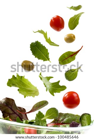 Falling vegetables for salad isolated on white