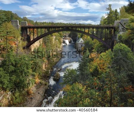 Falls and metal bridge - stock photo