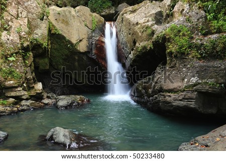 Falls and pool below La Mina Falls in the El Yunque rain forest in the Caribbean National Forest, Puerto Rico - stock photo