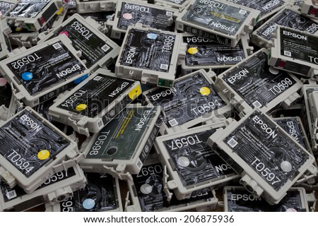 FALLS CHURCH, VA - JULY 17: A load of used non refillable OEM brand name ink cartridges going for plastic recycling lying on a heap on July 17, 2014 in Falls Church, VA. - stock photo