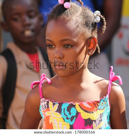 FALMOUTH, JAMAICA � MAY 11: An unidentified girl outside the port of Falmouth on MAY 11, 2011 in Jamaica ahead of the national labor day celebrations. - stock photo