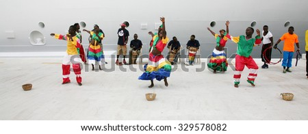 FALMOUTH, JAMAICA - SEPTEMBER 27, 2015: Dancers greet guests from the Royal Caribbean Cruise. September 27, 2015 in Falmouth, Jamaica - stock photo