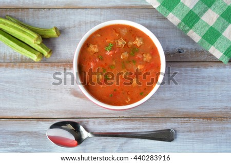 Falt lay of Traditional North African Okra soup on a wooden table. Food background and texture with copy space. - stock photo