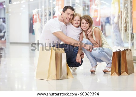 Families with a child in the store - stock photo