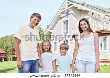 Families with children against the house - stock photo