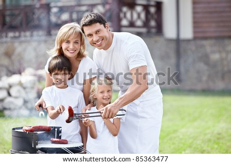 Families with children at barbecue - stock photo