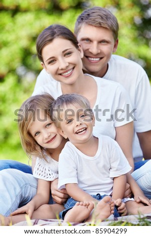 Families with children in park - stock photo