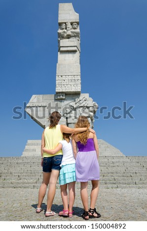 Family admire the Westerplatte monument - stock photo