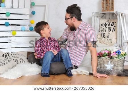 Family. Adorable kid and his father - stock photo