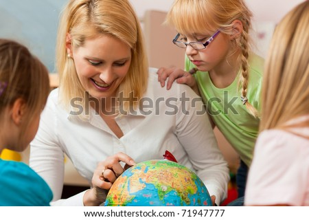 Family affairs - mother explaining the world to her children; presumably she is a teacher - stock photo