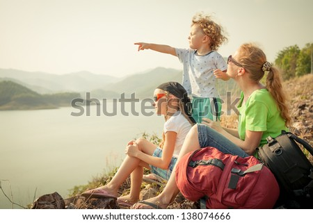 Family Afternoon on the Lake Shore - stock photo