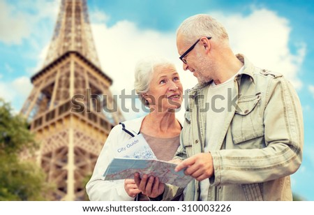 family, age, tourism, travel and people concept - senior couple with map and city guide over eiffel tower and blue sky background - stock photo