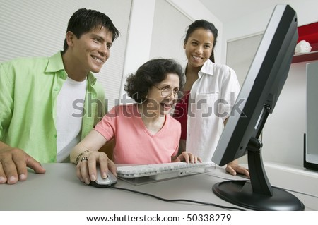 Family at Computer - stock photo