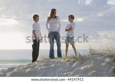 Family at the beach early morning
