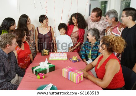 Family at young boy's birthday party - stock photo