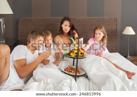 Family breakfast in a hotel room - stock photo