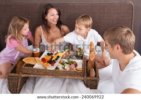 Family breakfast in hotel - stock photo