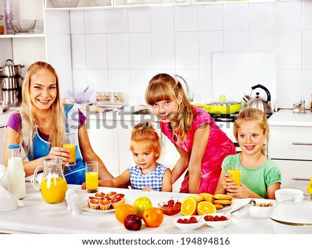 Family  breakfast with child at kitchen. - stock photo
