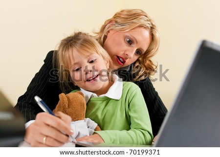 Family Business - telecommuter Businesswoman and mother is working in the internet while her daughter is playing with her teddy - stock photo