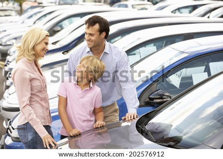Family buying new car - stock photo