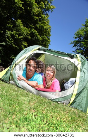 Family camping in mountain during summer vacation - stock photo