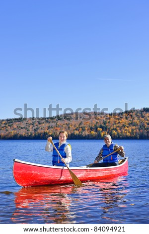 Family canoeing on Lake of Two Rivers, Ontario, Canada - stock photo