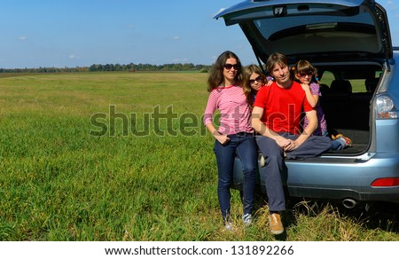 Family car trip on summer vacation, happy parents travel with kids and having fun. Car insurance concept