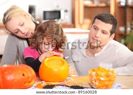 Family carving pumpkins - stock photo