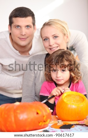 Family carving pumpkins together - stock photo