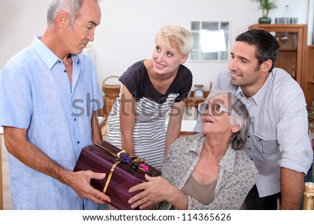 family celebrating a birthday - stock photo