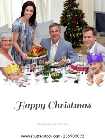 Family celebrating Christmas dinner with turkey against happy christmas - stock photo