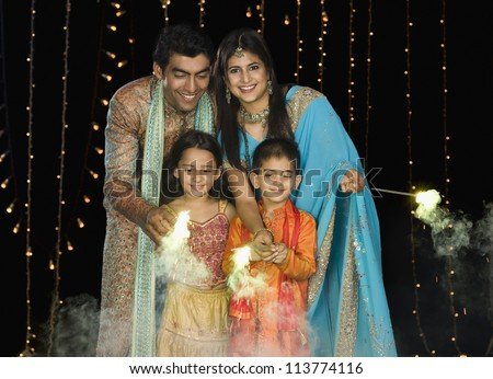 Family celebrating Diwali festival - stock photo