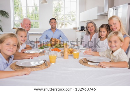 Family celebrating thanksgiving for dinner